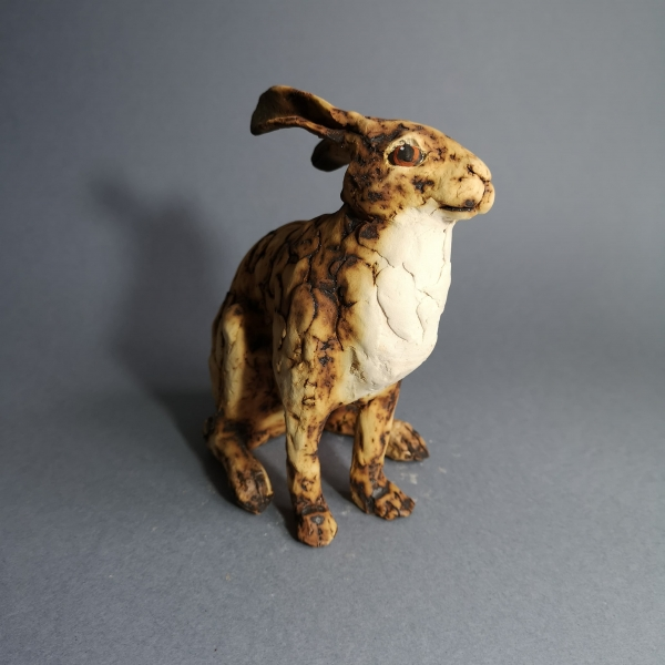ceramic hare, white chest.